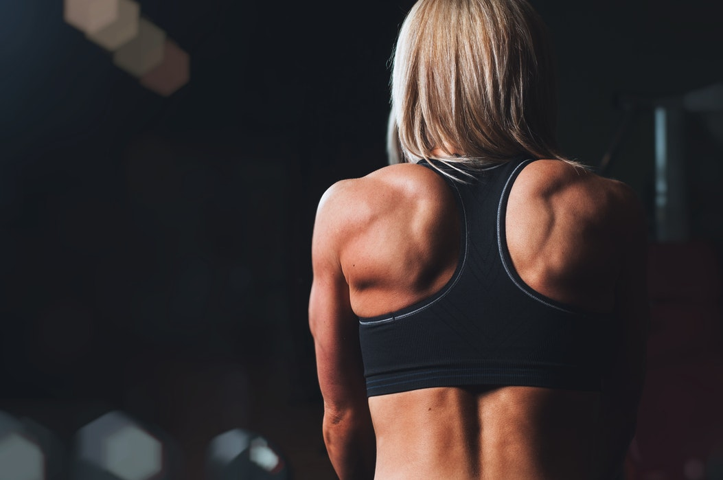 girls back muscle gym workout